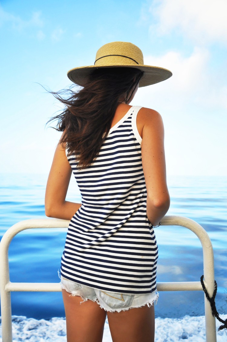 Girl on boat with hat