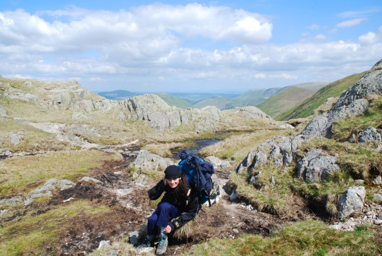 Girl climbing up hill in lake district