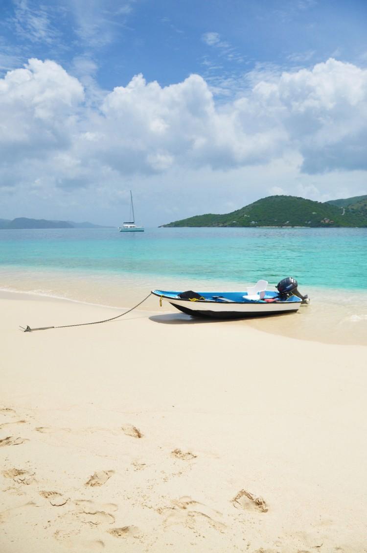 boat on sandy spit in jost van dyke in bvi