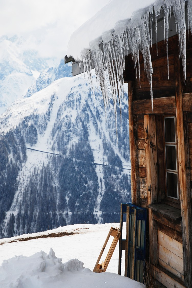 Icicles on a wood cabin