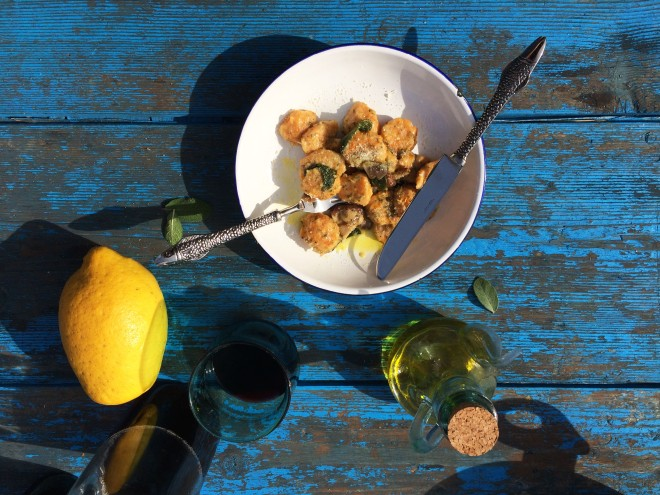 Home-made pumpkin gnocchi with lemon and sage on blue table
