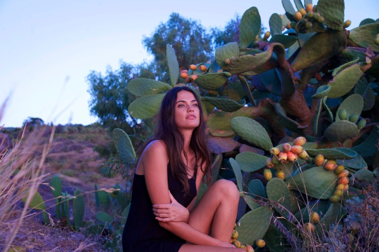 Girl in front of Prickly pears