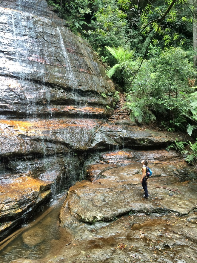 Girl under waterfall at blue mountains