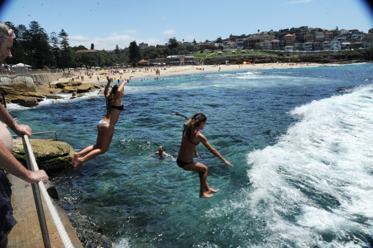 Girls jumping in tamarama