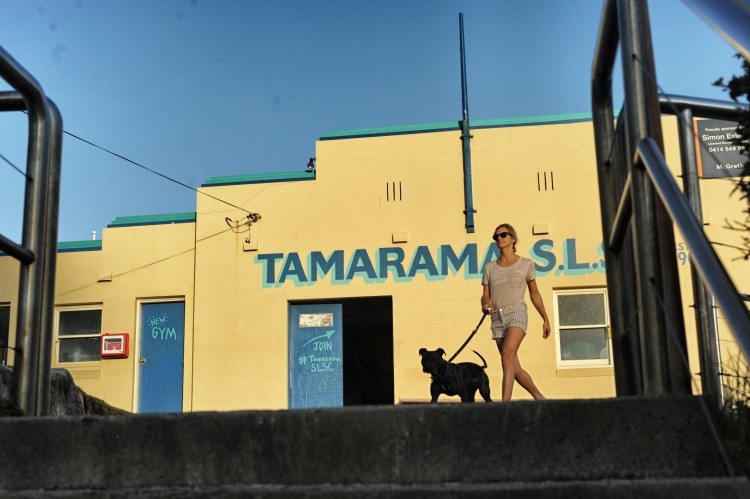 Girl walking dog on Tamarama