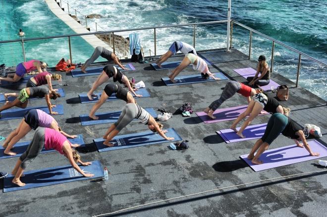 People doing yoga by Bondi Pools
