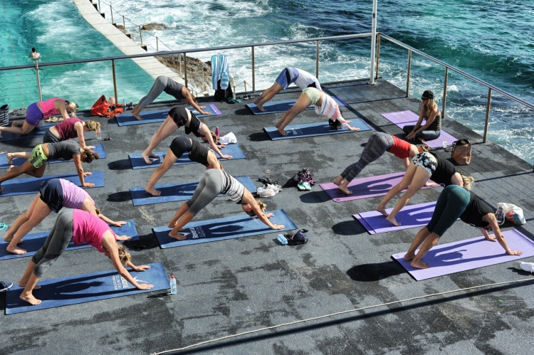 People doing yoga by Bondi Pools