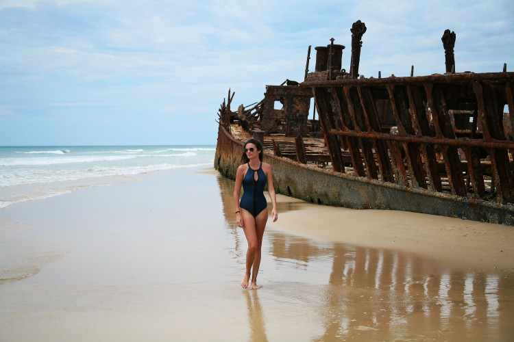 Girl in front of Maheno Shipwreck