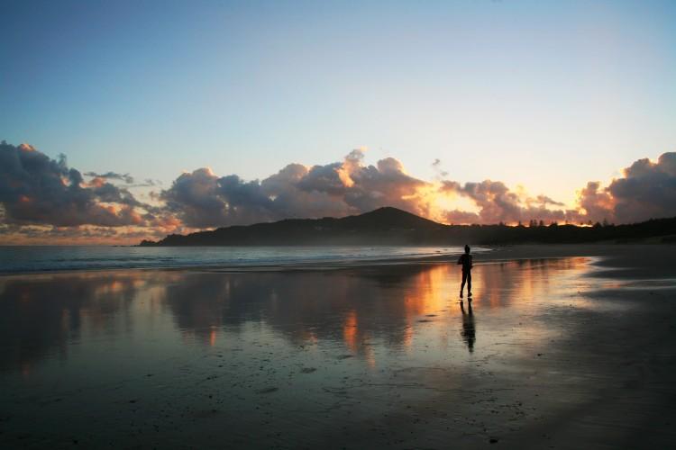 Girl jogging at sunrise in Byron Bay