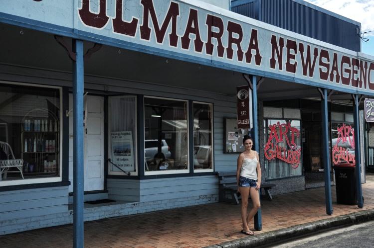 Girl in front of Australian shop
