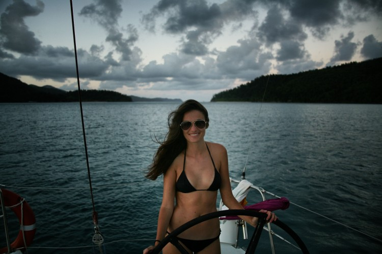 Girl sailing boat Whitsunday islands sunset