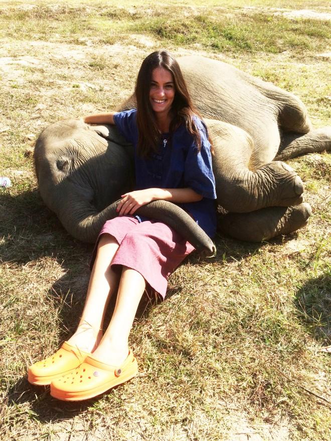 girl with baby elephant