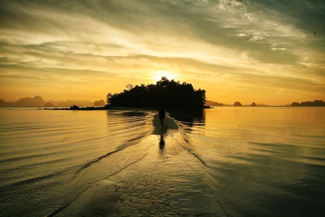 girl on beach thailand at sunrise