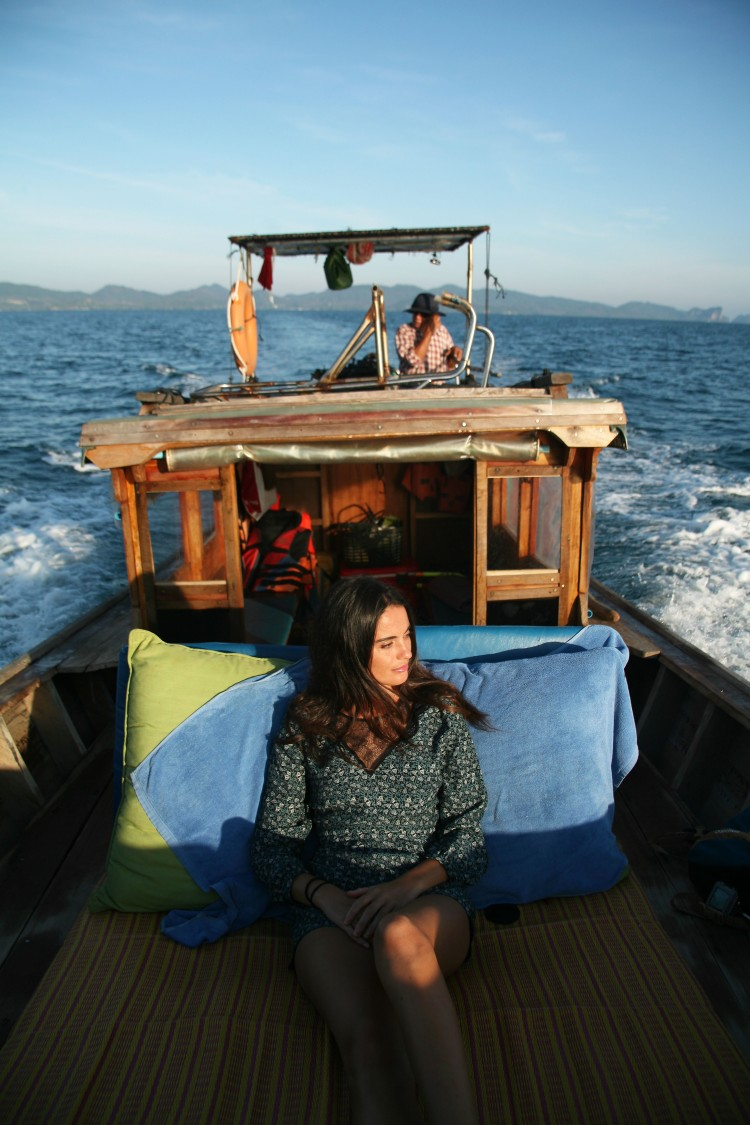 girl on longtail boat thailand