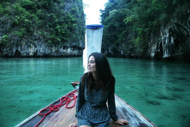 girl on boat in lagoon thailand