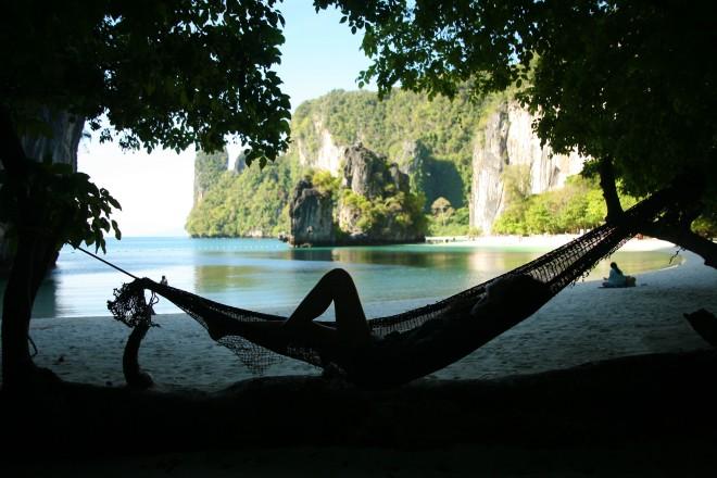 girl in hammock with rocks thailand