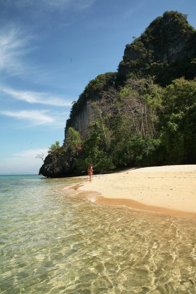 Girl on beach with rocks thailand