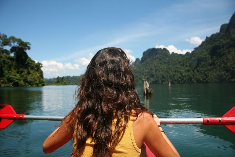 Girl kayaking in Thailand