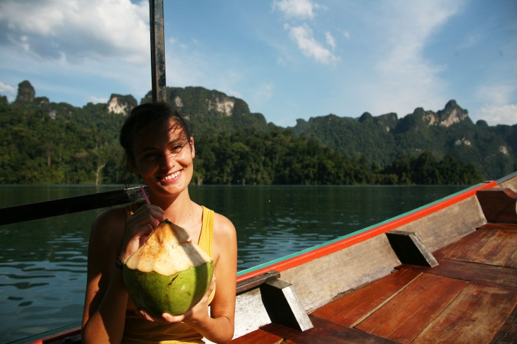 Girl with coconut on longtail