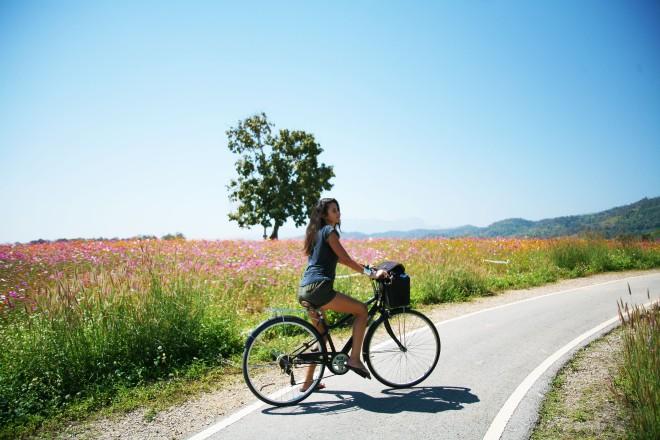 girl on bike in thailand