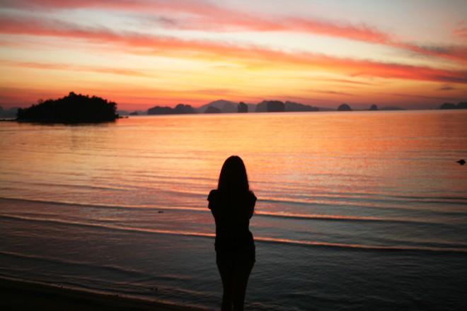 Girl in front of Sunrise Koh yao noi thailand