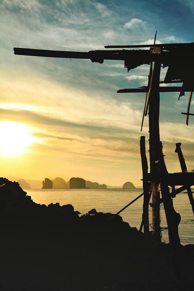 rocks and fisherman hut at sunrise