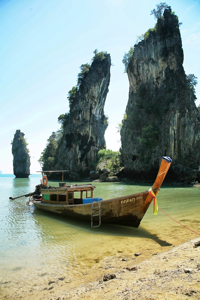 longtail boats with rocks thailand