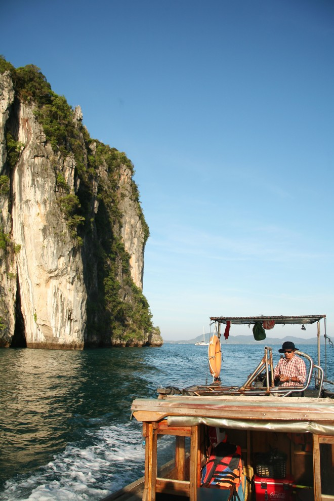 fisherman on longtail boat thailand