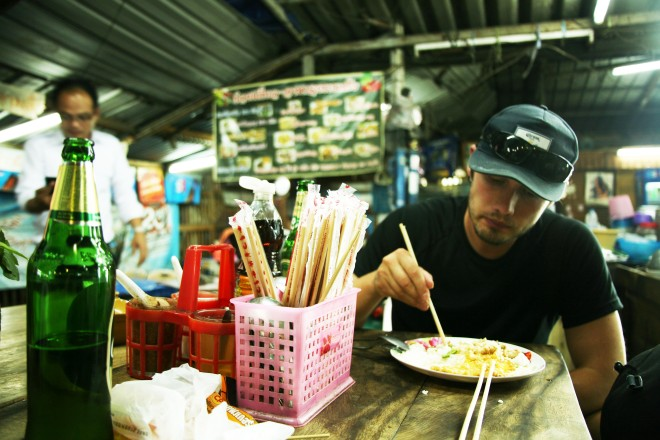 man eating noodles in thailand